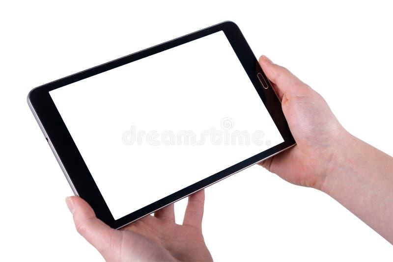 Tableta en manos de las mujeres en fondos blancos imagen de archivo