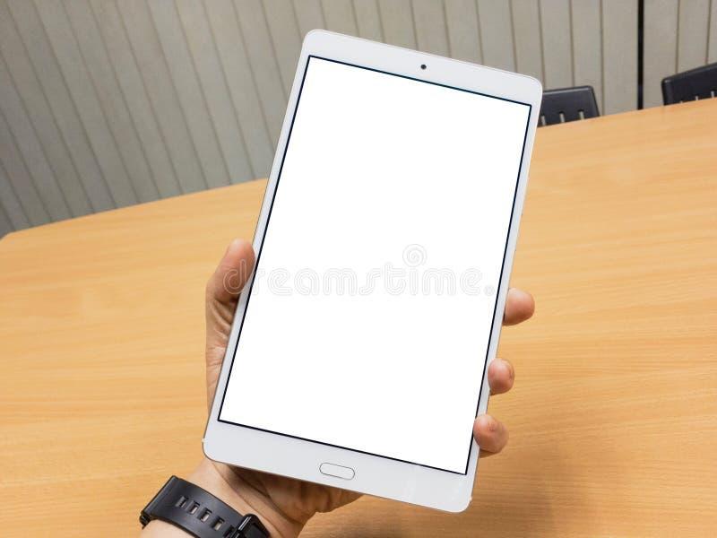 Tableta en una mano imagenes de archivo