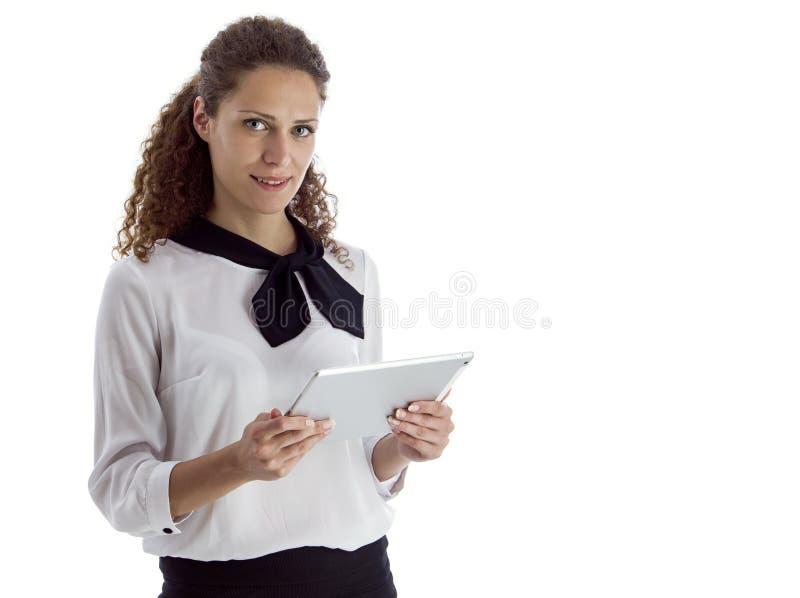 Tableta hermosa de la tenencia de la chica joven fotografía de archivo libre de regalías