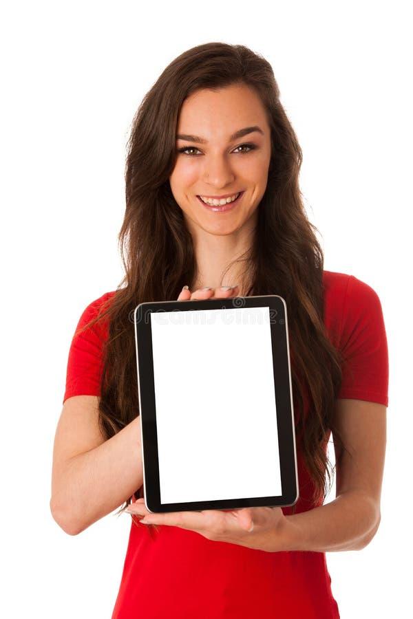 Tableta joven hermosa de la demostración de la mujer de negocios con la pantalla para el co fotos de archivo