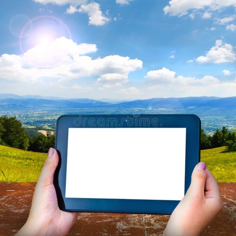 Tableta negra con una pantalla en blanco stock de ilustración