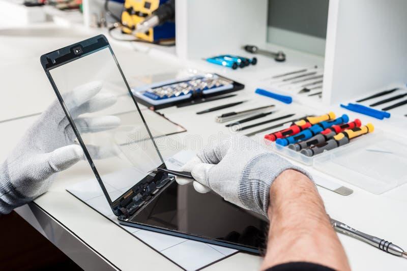 Tableta, reparación de la vaina fotos de archivo