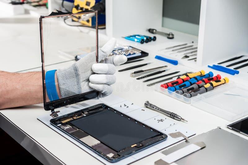 Tableta, reparación de la vaina imágenes de archivo libres de regalías