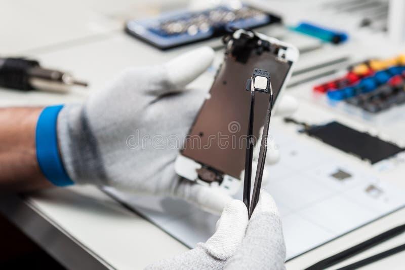 Tableta, reparación de la vaina fotografía de archivo