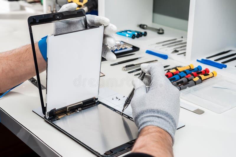 Tableta, reparación de la vaina imagen de archivo