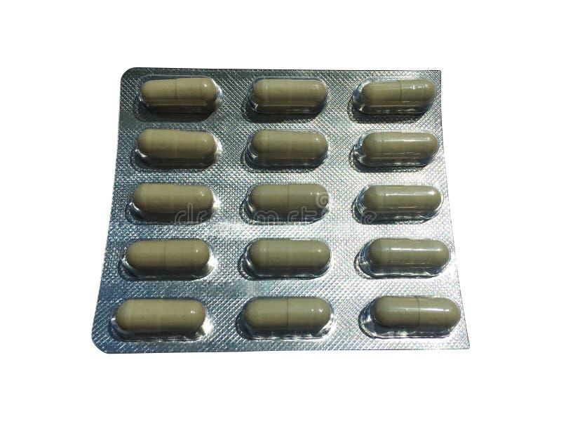 Tabletas de Pils en el paquete de ampolla aislado en blanco imagen de archivo