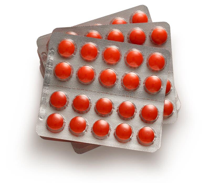 Tabletas en el embalaje plástico foto de archivo libre de regalías