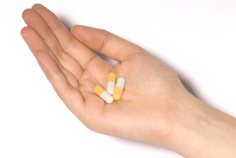 tabletki rąk obraz royalty free