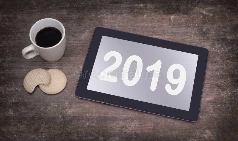 Tabletnoten-Computergerät auf Holztisch - 2019 lizenzfreie stockfotos