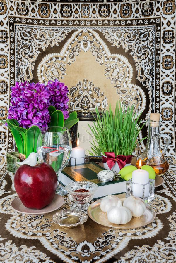Tabletop with Haft-seen elements for Nowruz royalty free stock photography