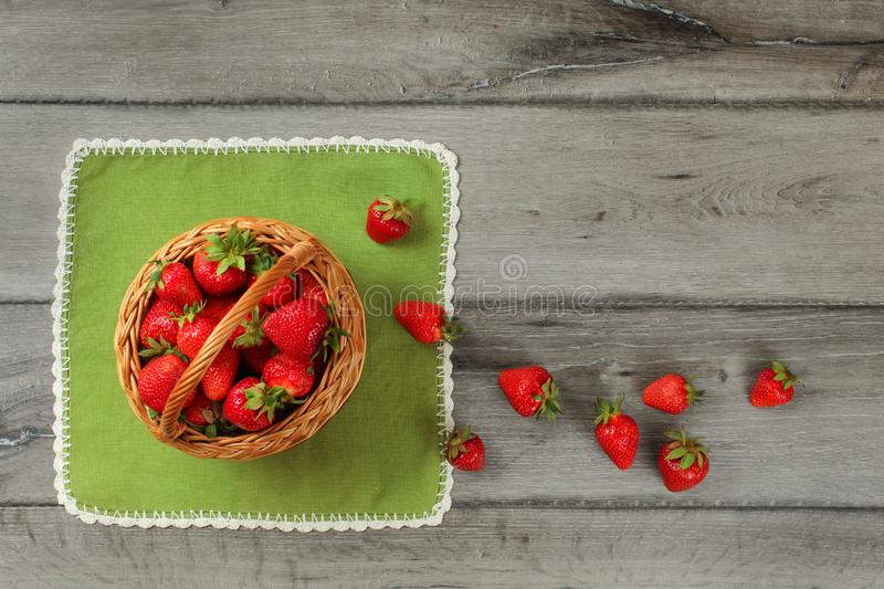 Tabletop photo, basket with strawberries , some of them spilled stock image