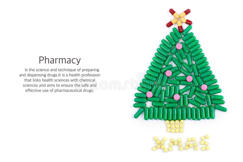 Tablets in form of Christmas tree and words under it stock image