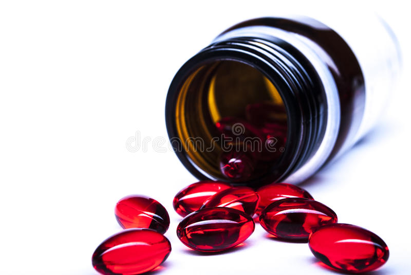 Tablets. Pills on a white background. medicine on a white background. tablets, capsules red . vitamins capsules in red on a white background . tablets in the royalty free stock image
