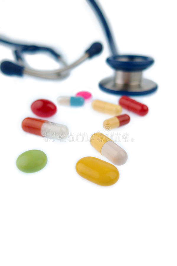 Tablets and a stethoscope. Colorful tablets and a stethoscope, symbol photo for diagnostics, heart disease and interactions stock images