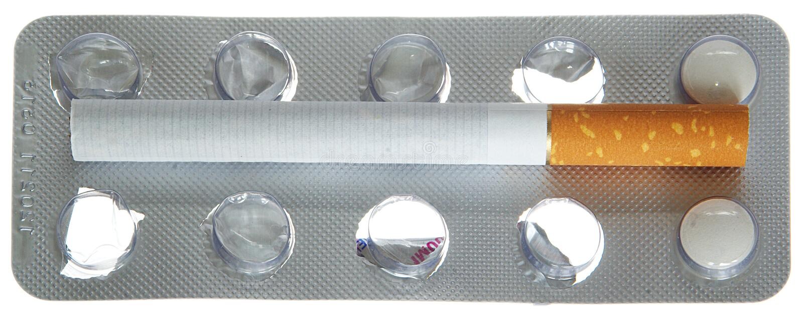 Tablets vs cigarettes. Pack of tablets with cigarets stock image