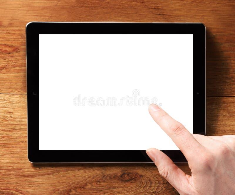 Tablette émouvante de Digital de doigt avec l'écran blanc photographie stock libre de droits