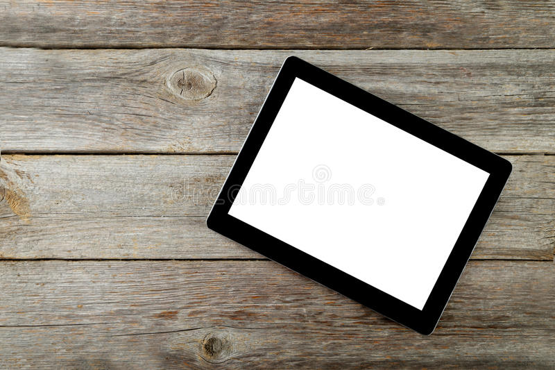 Tablette avec l 39 cran blanc sur le fond en bois gris photo for Photo fond ecran tablette
