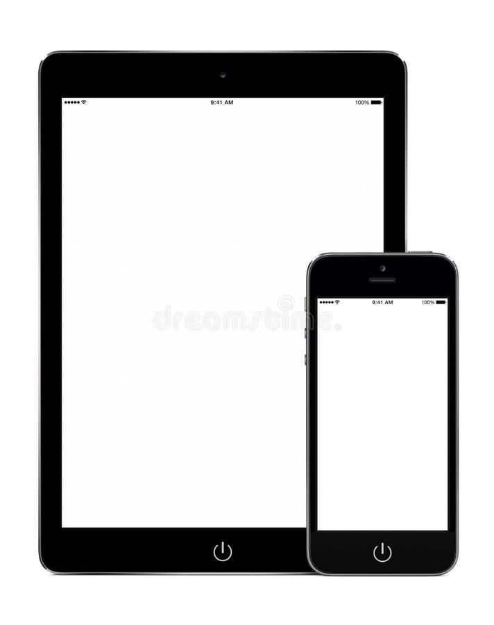 Tablette et téléphone intelligent dans la maquette d'orientation de portrait image stock