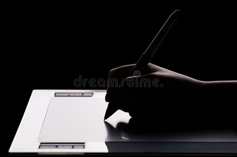 Tablette graphique et main photos stock