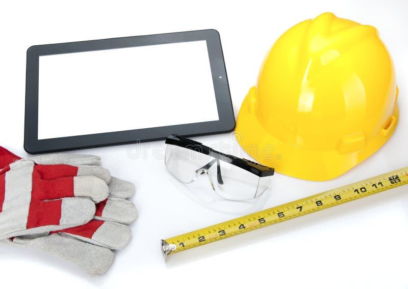Tablette utilisée pour des modèles de construction image stock