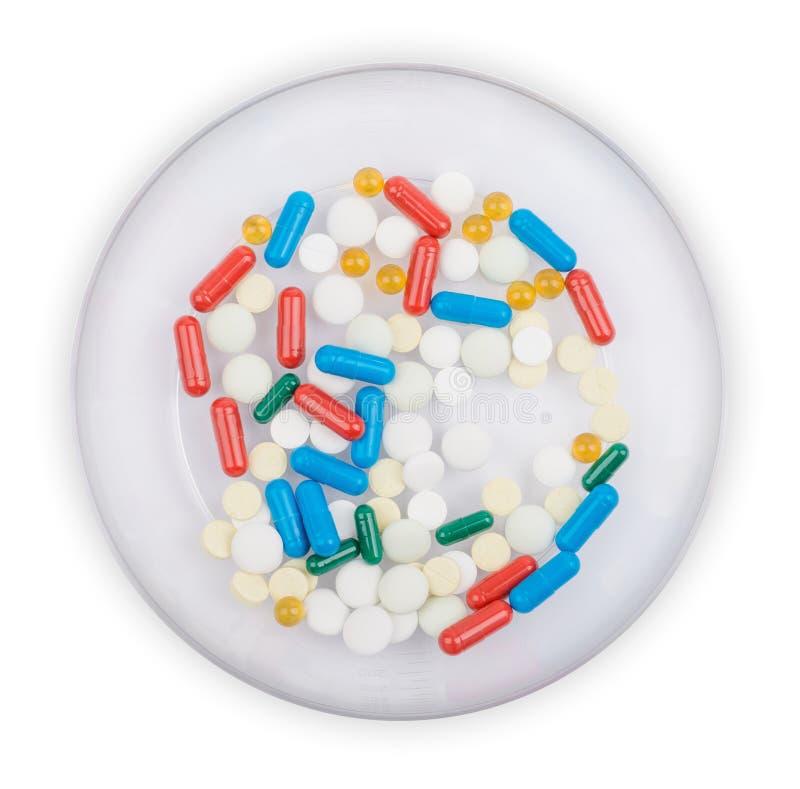 Tabletten die aan kom ten grondslag liggen Geïsoleerd op wit royalty-vrije stock foto's