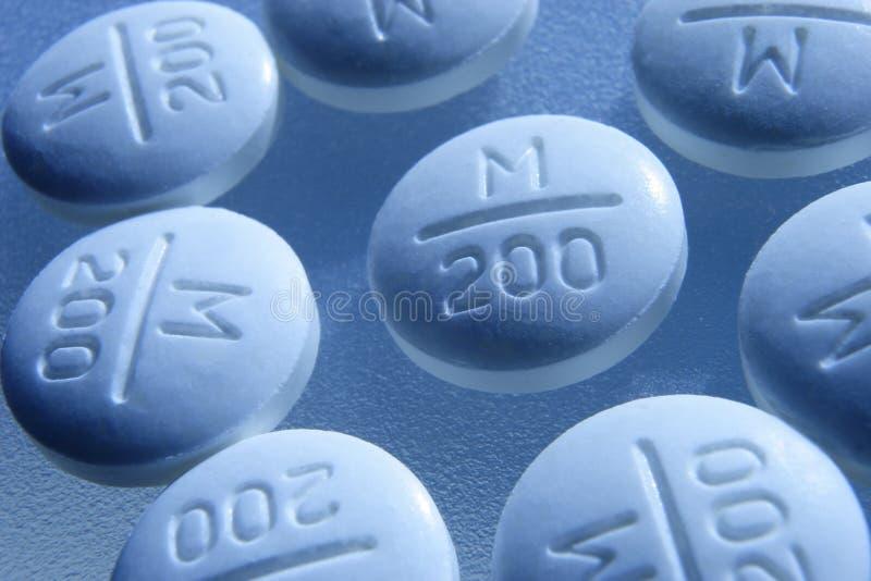 Download Tabletten Met Een Wenk Van Blauw Stock Afbeelding - Afbeelding bestaande uit medicijn, tabletten: 286569
