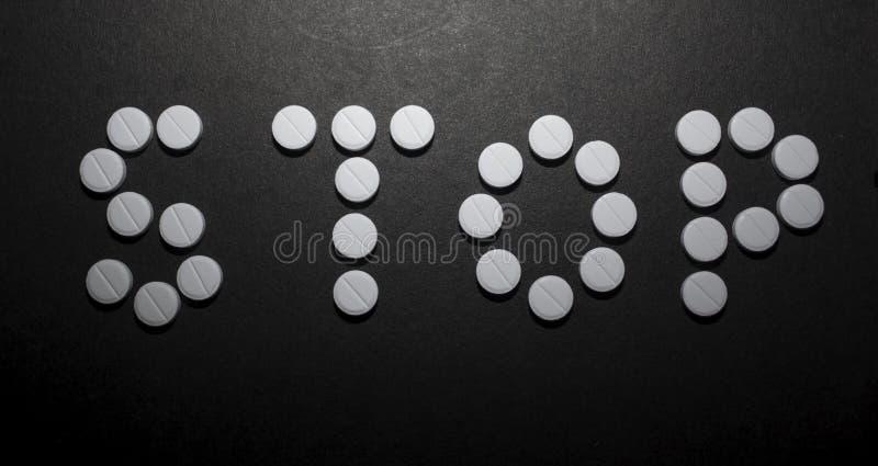 Tabletten met het woordeinde stock foto