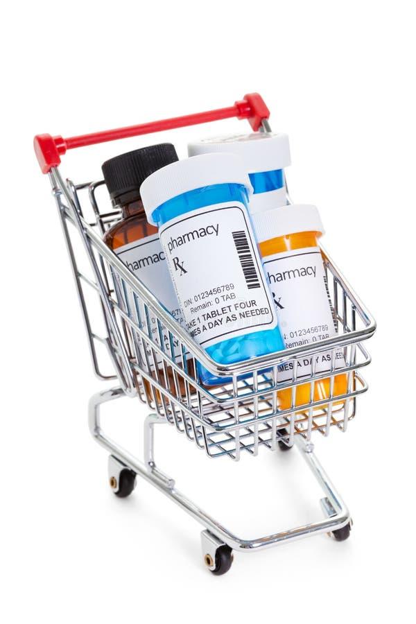 Tablettenfläschchen und Warenkorb stockbilder