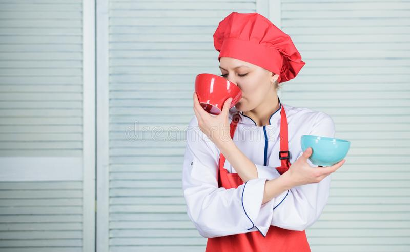 Tableware choice. culinary cuisine. girl in apron and hat hold bowls. cook in restaurant, uniform. professional chef royalty free stock photo