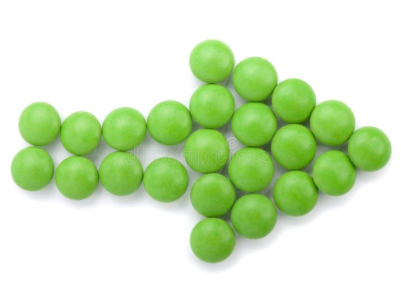 Tablillas verdes en la formación de la flecha imagenes de archivo