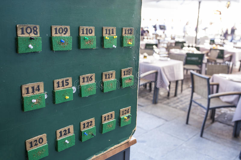 Tabloid for tables orders at terrace restaurant. Green tabloid for tables orders at terrace restaurant, Spain stock image