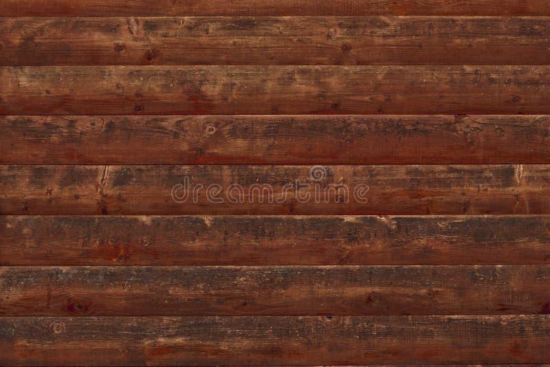 Tablones de madera lamentables de Brown Superficie de una cerca decrépita de madera Tablaje dilapidado del roble Textura de viejo foto de archivo libre de regalías