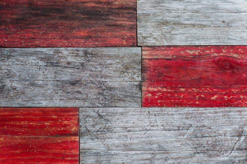 Tablones de madera sucios rojos y grises foto de archivo