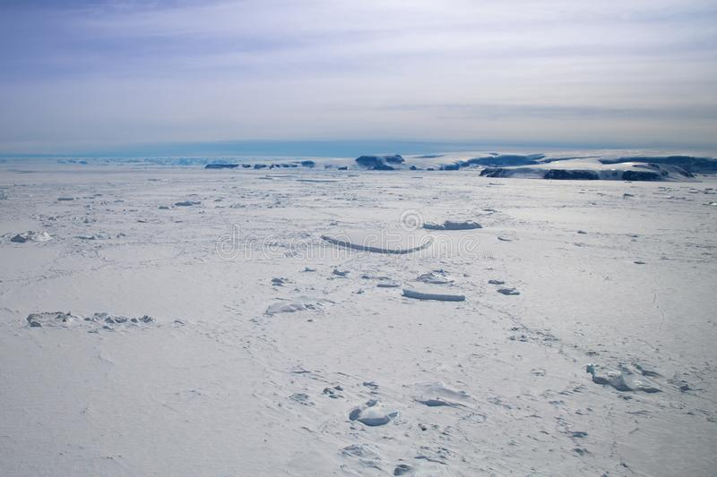 Sea ice and the Antarctic Peninsula in the Weddell Sea. Tabular icebergs and the Antarctic Peninsula as seen from a helicopter in the frozen Weddell Sea stock images