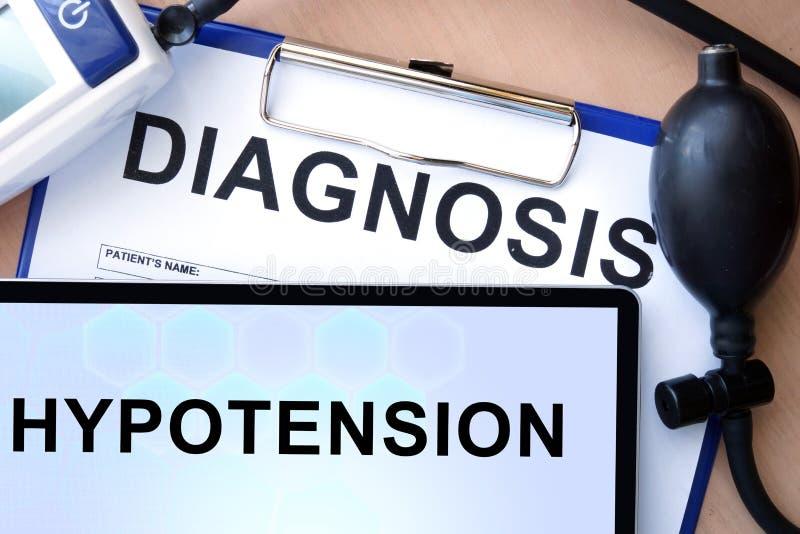 Tabuleta com a hipotensão do diagnóstico fotografia de stock