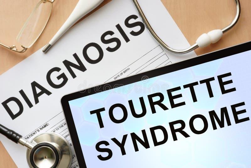 Tabuleta com síndrome e estetoscópio de Tourette do diagnóstico imagens de stock royalty free
