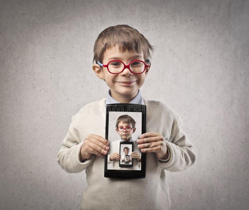 Tabuleta da criança fotografia de stock royalty free