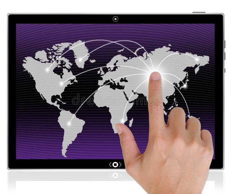 Tabuleta e mão do PC que empurram uma tecla. fotografia de stock royalty free