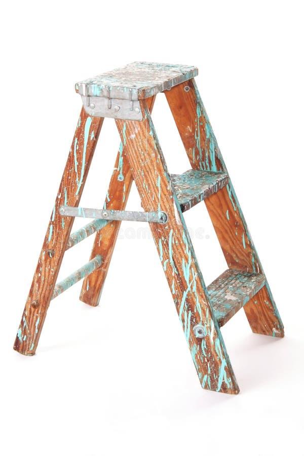 Taburete de paso de progresión de madera usado fotografía de archivo