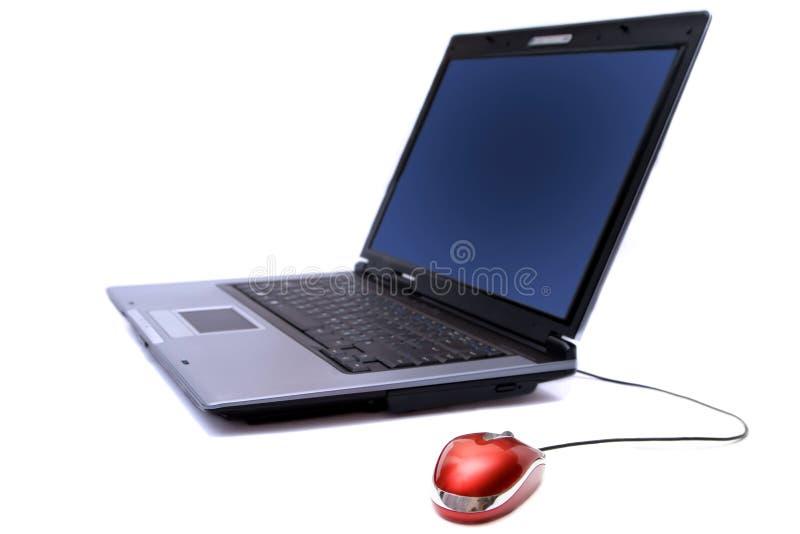 Taccuino con il mouse del calcolatore immagini stock libere da diritti