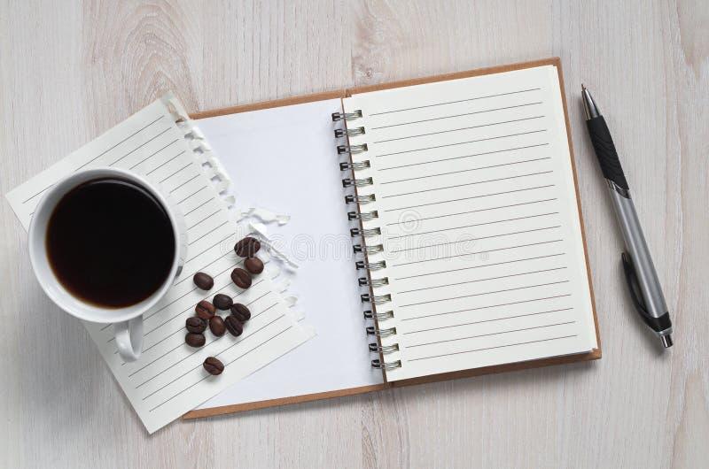 Taccuino e caffè immagine stock libera da diritti