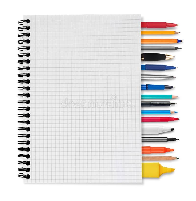 Taccuino, penne e matite immagini stock