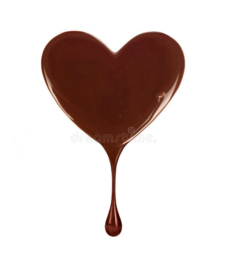 Tache de chocolat sous forme de coeur avec la baisse en baisse photo stock