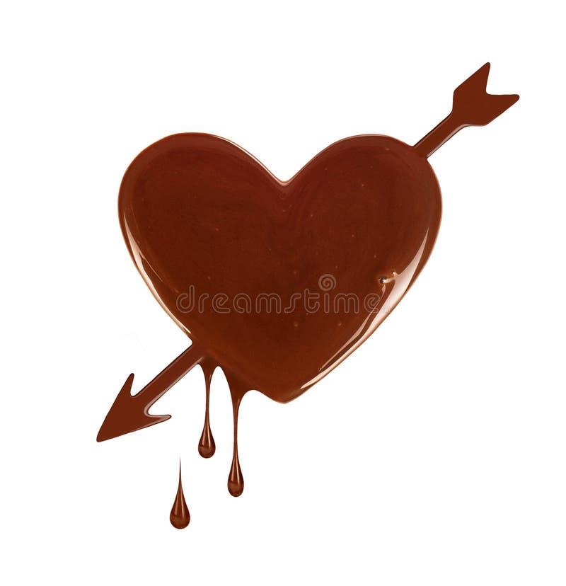 Tache de chocolat sous forme de coeur avec la flèche photographie stock libre de droits