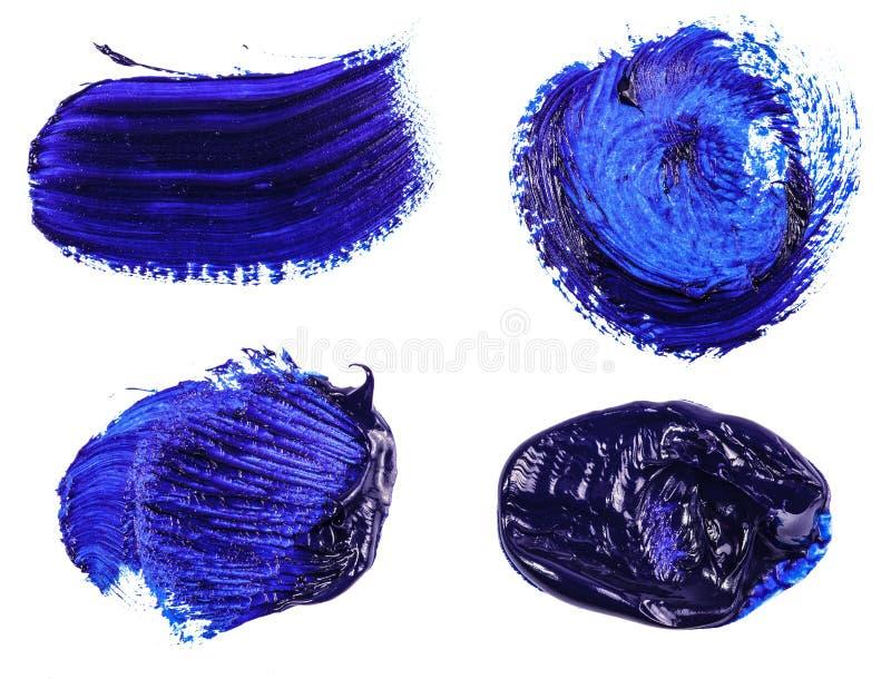 Tache de peinture à l'huile bleue sur le blanc positionnement images libres de droits