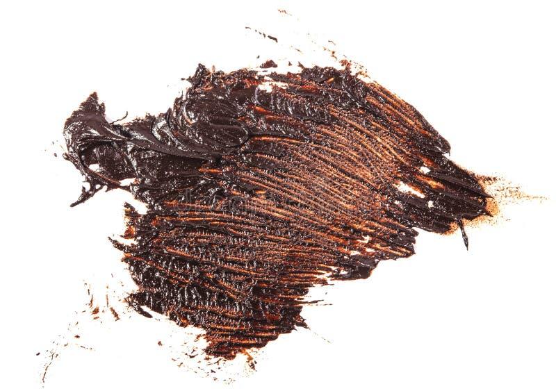 Tache de peinture brune d'huile sur le blanc image stock