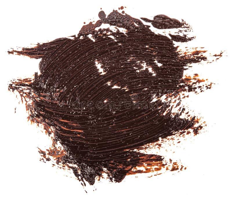 Tache de peinture brune d'huile sur le blanc photo stock