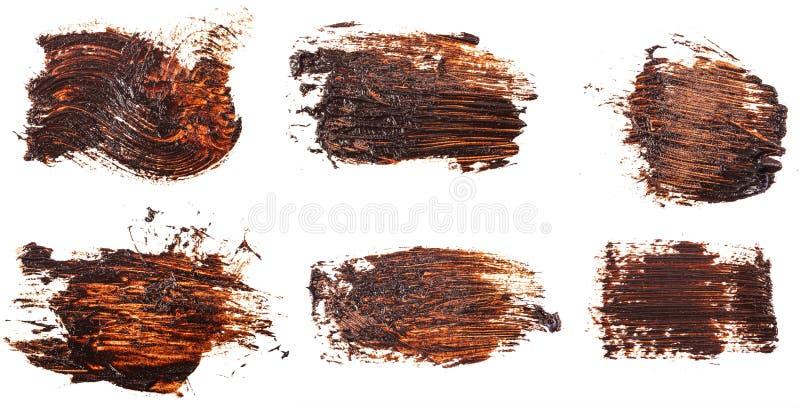 Tache de peinture brune d'huile sur le blanc positionnement photos stock