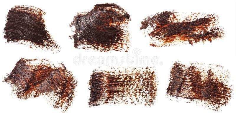Tache de peinture brune d'huile sur le blanc positionnement photographie stock