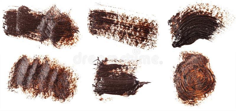 Tache de peinture brune d'huile sur le blanc positionnement images stock